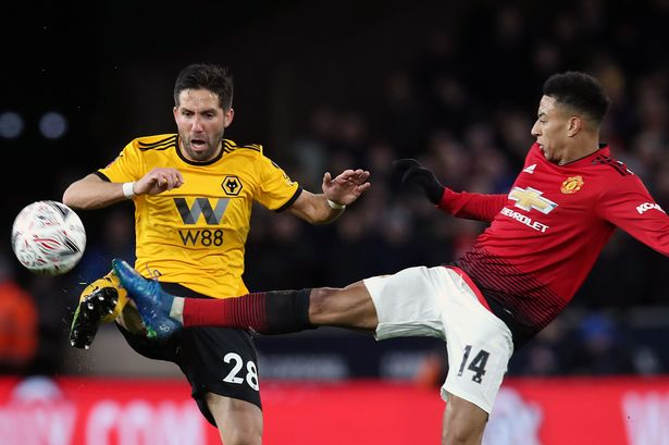 Joao Moutinho battlliing Jesse Lingard for the ball in last seasons league defeat at the Molinuex.